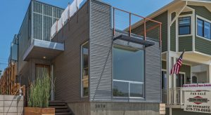 Developer covers new homes in metal, fiberglass
